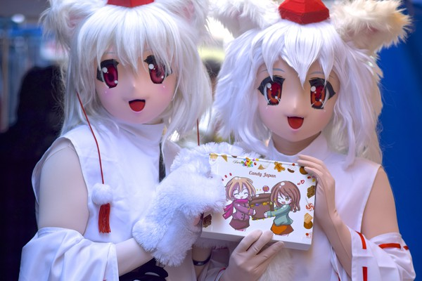 anime characters holding Japanese candy box